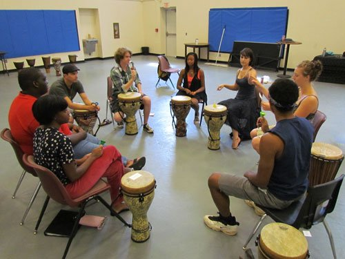 drumming class of people learning about teamwork